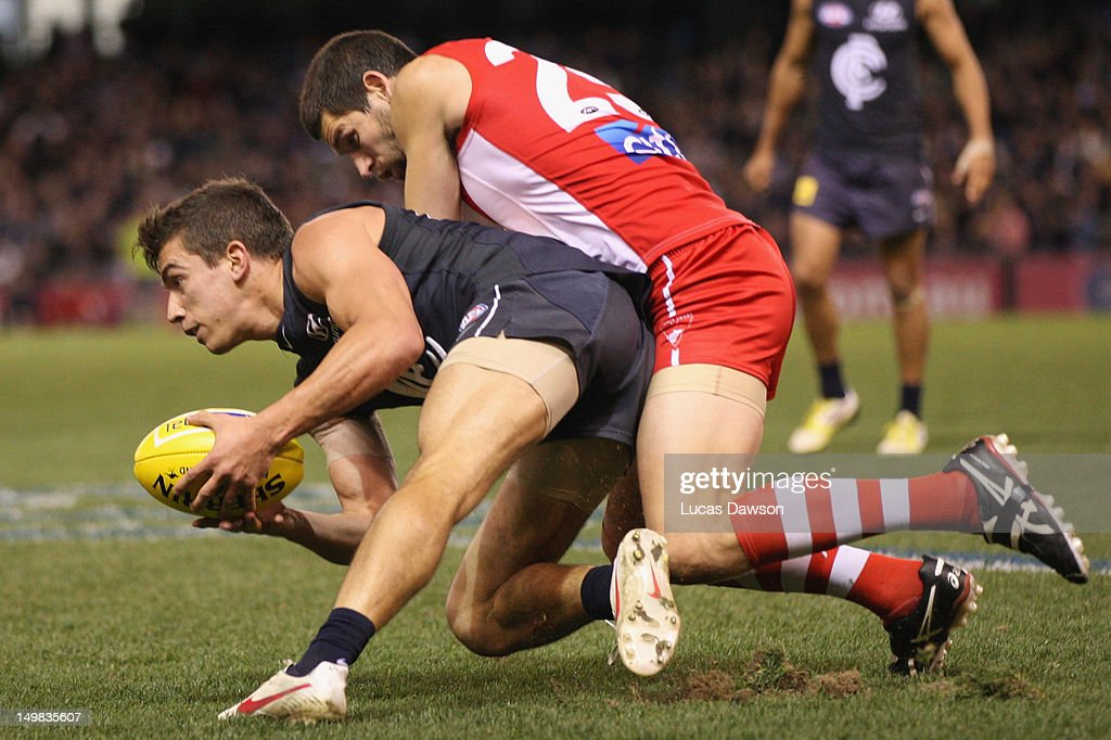 Andrew Carrazzo of the Blues is tackled during the round 19 AFL match between the Carlton Blues and the Sydney Swans at Etihad Stadium on August 5, 2012 in Melbourne, Australia.