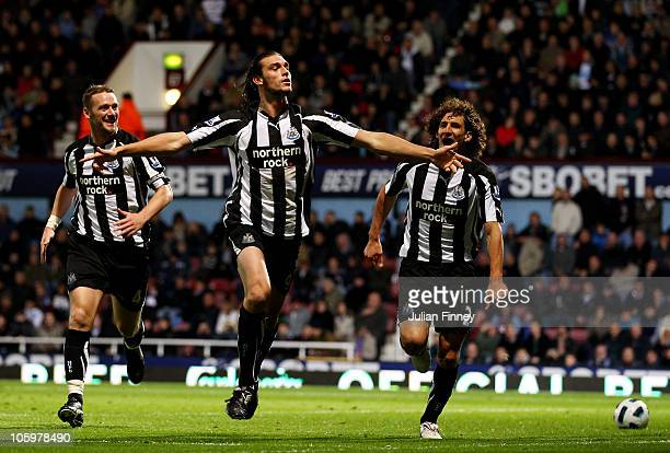 Andrew Carroll of Newcastle United celebrates scoring their second goal during the Barclays Premier League match between West Ham United and...
