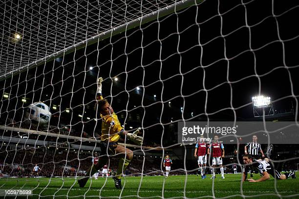 Andrew Carroll of Newcastle United scores their second goal past Robert Green of West Ham during the Barclays Premier League match between West Ham...