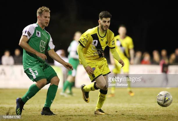 Andrew Cartanos of Heidelberg United and Jacob Alexander of Bentleigh Greens compete for the ball during the FFA Cup quarterfinal match between...