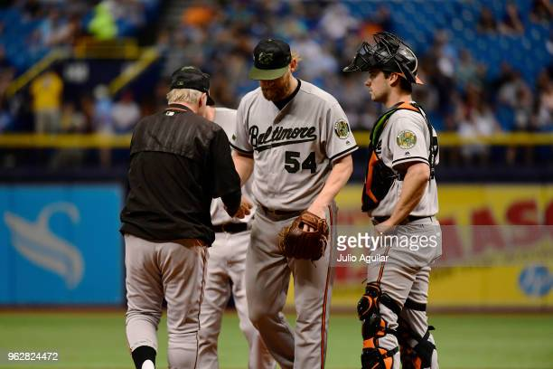 Andrew Cashner of the Baltimore Orioles gets relieved in the sixth inning against the Tampa Bay Rays on May 26 2018 at Tropicana Field in St...