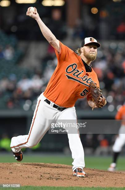 Andrew Cashner of the Baltimore Orioles pitches in the second inning against the Minnesota Twins at Oriole Park at Camden Yards on March 31 2018 in...