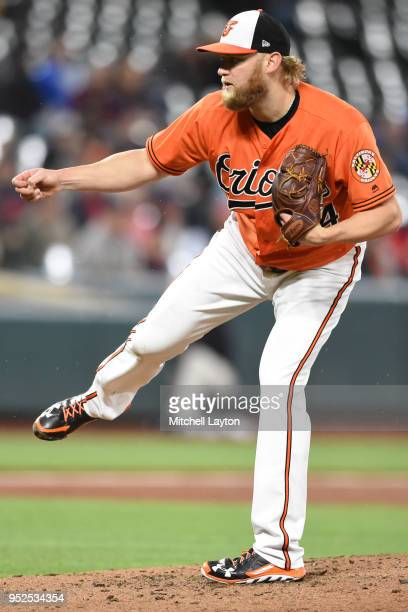 Andrew Cashner of the Baltimore Orioles pitches in the third inning during a baseball game against the Detroit Tigers at Oriole Park at Camden Yards...