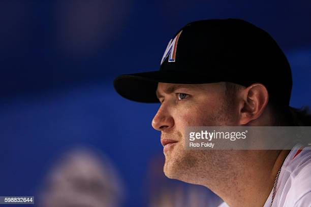 Andrew Cashner of the Miami Marlins looks on from the dugout during the game against the San Diego Padres at Marlins Park on August 26 2016 in Miami...