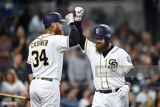 Andrew Cashner of the San Diego Padres congratulates teammate Derek Norris after he hit a tworun home run during a baseball game against the Colorado...