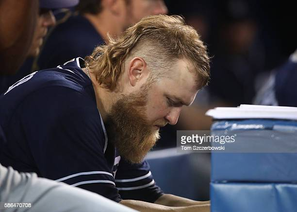 Andrew Cashner of the San Diego Padres looks on from the dugout after being relieved during MLB game action against the Toronto Blue Jays on July 26...