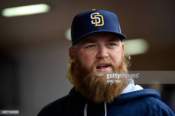 Andrew Cashner of the San Diego Padres talks with teammates prior to the start of a baseball game against the San Francisco Giants at PETCO Park on...