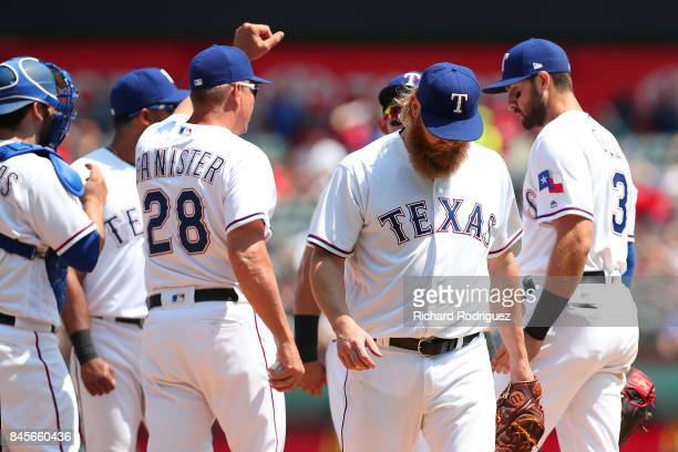Andrew Cashner of the Texas Rangers leaves in the 8th inning after hitting Todd Frazier of the New York Yankees with a pitch in a game at Globe Life...