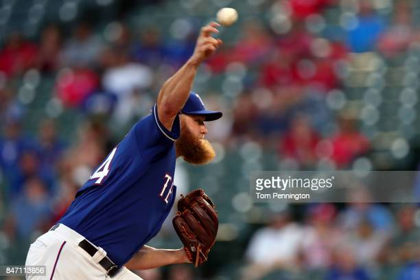 Andrew Cashner of the Texas Rangers pitches against the Seattle Mariners in the top of the first inning at Globe Life Park in Arlington on September...