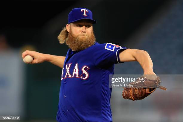 Andrew Cashner of the Texas Rangers pitches during the first inning of a game against the Los Angeles Angels of Anaheim at Angel Stadium of Anaheim...