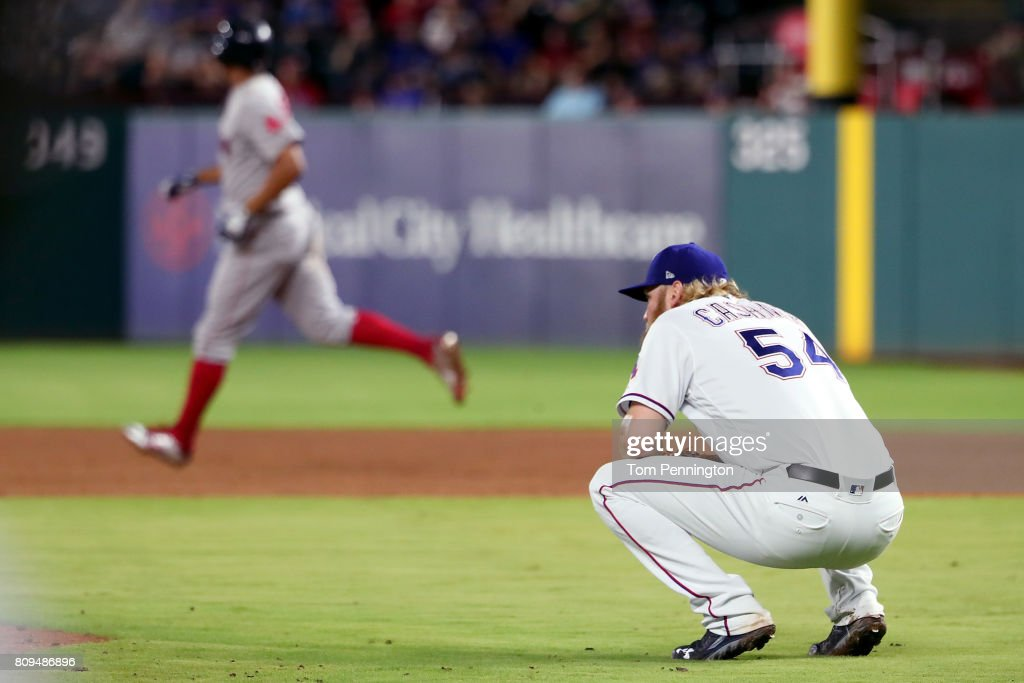 Andrew Cashner #54 of the Texas Rangers reacts after giving up a two run home run against Xander Bogaerts #2 of the Boston Red Sox in the top of the sixth inning at Globe Life Park in Arlington on July 5, 2017 in Arlington, Texas.