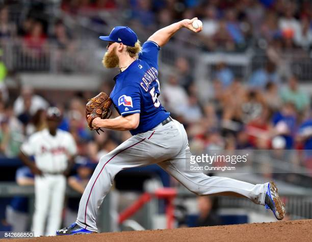 Andrew Cashner of the Texas Rangers throws a first inning pitch against the Atlanta Braves at SunTrust Park on September 4 2017 in Atlanta Georgia