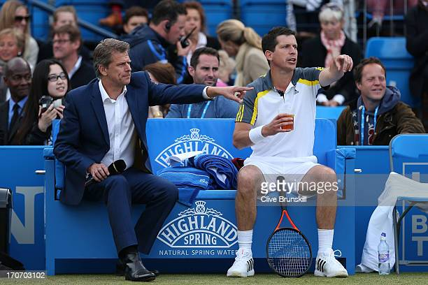 Andrew Castle amd Tim Henman gesture during the Rally Against Cancer charity match on day seven of the AEGON Championships at Queens Club on June 16...