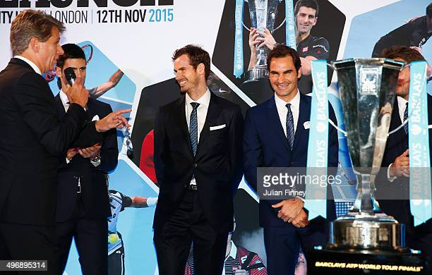 Andrew Castle interviews Andy Murray of Great Britain and Roger Federer of Switzerland following the draw for the singles during the Barclays ATP...