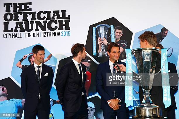 Andrew Castle interviews Roger Federer of Switzerland following the draw for the singles during the Barclays ATP World Tour Finals Draw at City Hall...