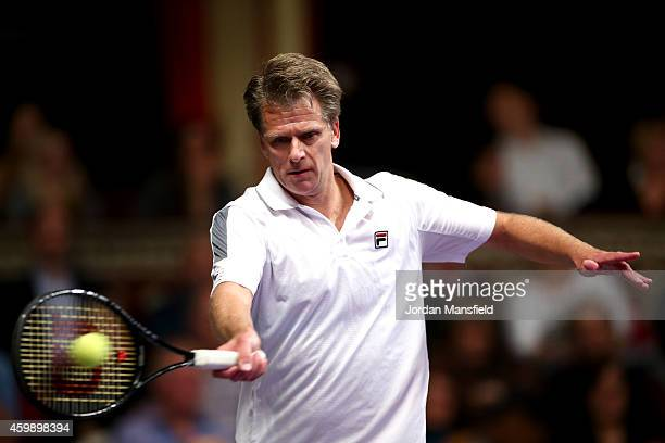 Andrew Castle of Great Britain plays a forehand during the Mens Doubles match between Mansour Bahrami and Andrew Castle against Pat Cash and Peter...