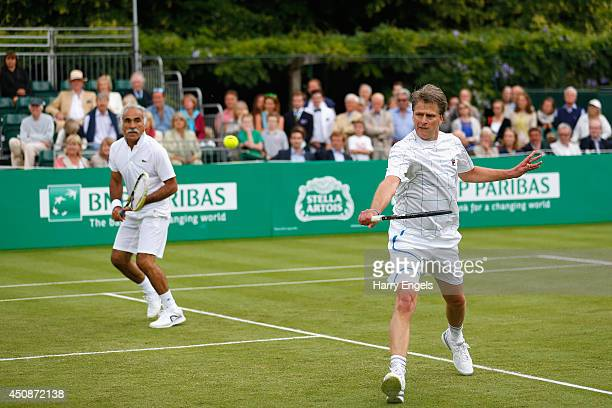 Andrew Castle plays a volley during his Men's Doubles exhibition match against Pat Cash and Peter McNamara at the BNP Paribas Tennis Classic at the...