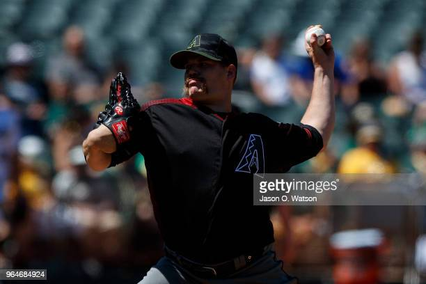 Andrew Chafin of the Arizona Diamondbacks pitches against the Oakland Athletics during the seventh inning at the Oakland Coliseum on May 27 2018 in...