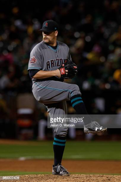 Andrew Chafin of the Arizona Diamondbacks pitches against the Oakland Athletics during the ninth inning at the Oakland Coliseum on May 25 2018 in...
