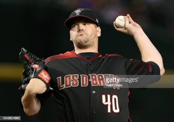 Andrew Chafin of the Arizona Diamondbacks pitches against the Colorado Rockies during the eighth inning of an MLB game at Chase Field on September 22...