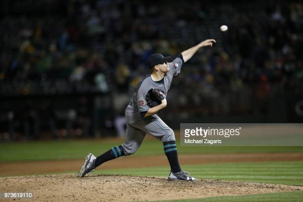 Andrew Chafin of the Arizona Diamondbacks pitches during the game against the Oakland Athletics at the Oakland Alameda Coliseum on May 25 2018 in...