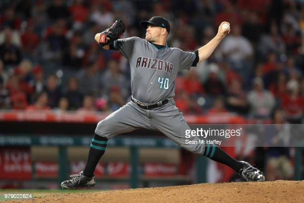 Andrew Chafin of the Arizona Diamondbacks pitches during the seventh inning of a game against the Los Angeles Angels of Anaheim at Angel Stadium on...