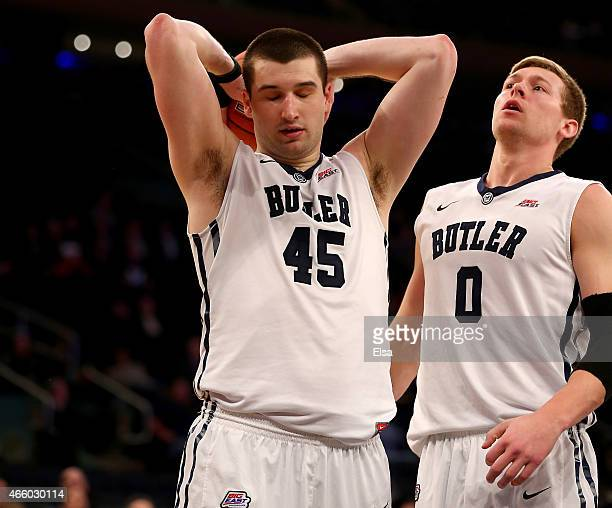 Andrew Chrabascz and Austin Etherington of the Butler Bulldogs react late in the overtime period against the Xavier Musketeers during a quarterfinal...