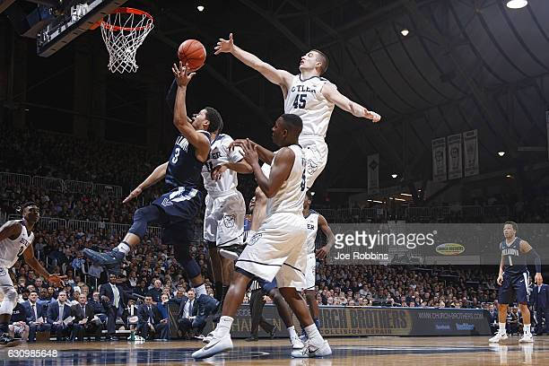 Andrew Chrabascz of the Butler Bulldogs defends against Josh Hart of the Villanova Wildcats in the first half of the game at Hinkle Fieldhouse on...