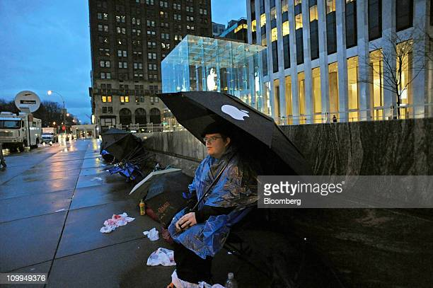 Andrew Christian waits in front of the Apple store on Fifth Avenue in the early morning hours to purchase Apple Inc's iPad 2 which goes on sale today...