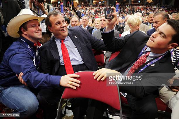 Andrew Christie takes a photo of a delegate and his father New Jersey Gov Chris Christie while attending the first day of the Republican National...