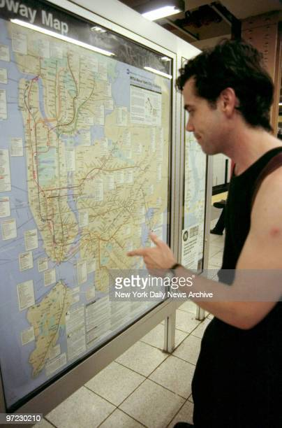 Andrew Cicchetti reads subway map at 36th St and Fourth Ave in Brooklyn