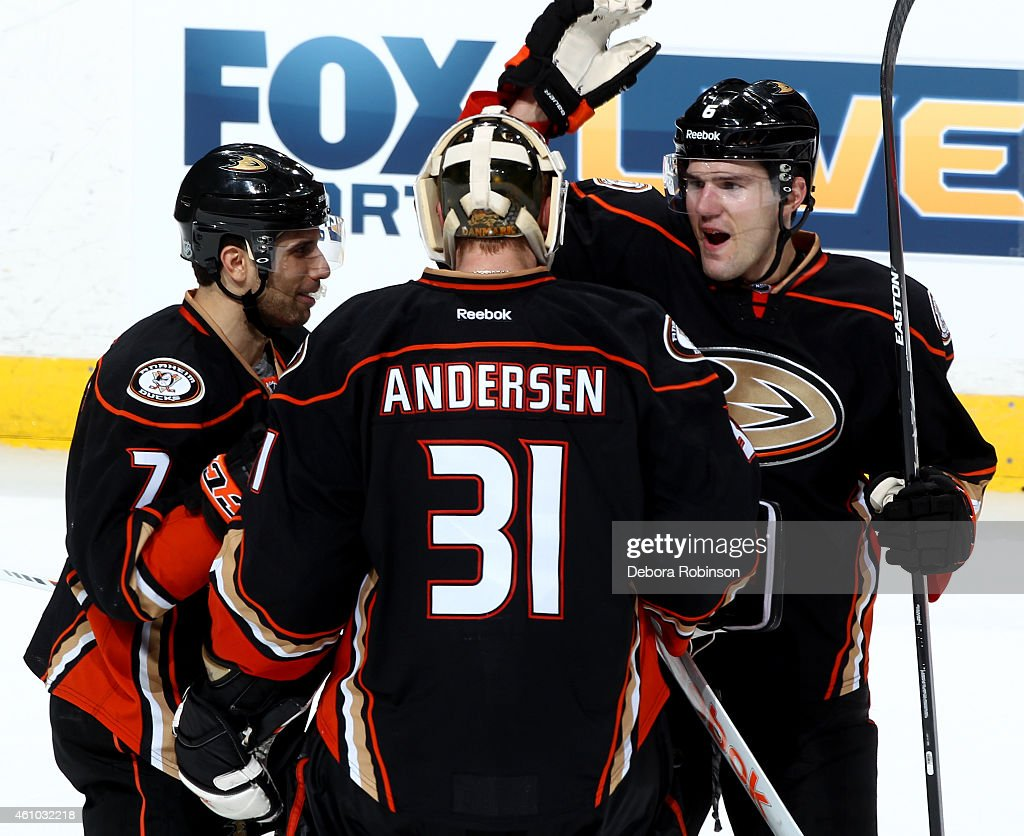 Andrew Cogliano #7, Frederik Andersen #31 and Ben Lovejoy #6 of the Anaheim Ducks celebrate the Ducks' 4-3 shootout win against the Nashville Predators on January 4, 2015 at Honda Center in Anaheim, California.