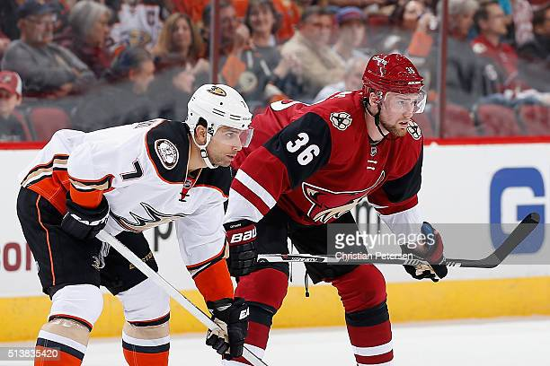 Andrew Cogliano of the Anaheim Ducks and Jiri Sekac of the Arizona Coyotes await a face off during the NHL game at Gila River Arena on March 3 2016...