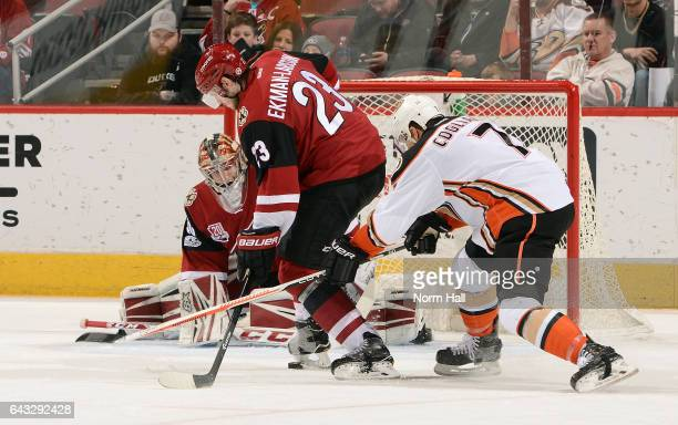 Andrew Cogliano of the Anaheim Ducks and Oliver EkmanLarsson of the Arizona Coyotes battle for a loose puck in front of goalie Marek Langhamer of the...