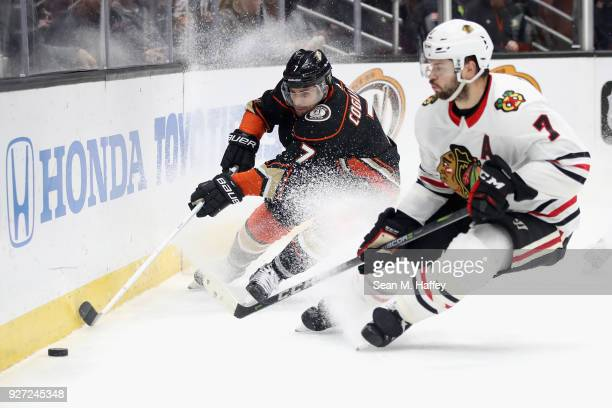 Andrew Cogliano of the Anaheim Ducks battles Brent Seabrook of the Chicago Blackhawks for a loose puck during the third period of a game at Honda...