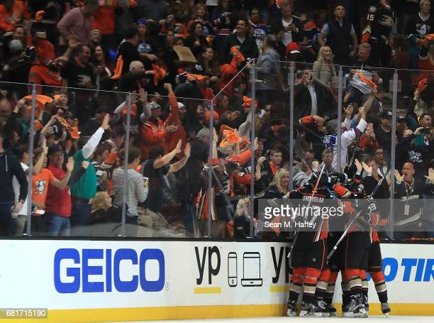 Andrew Cogliano of the Anaheim Ducks celebrates with teammates after scoring a goal against the Edmonton Oilers in Game Seven of the Western...