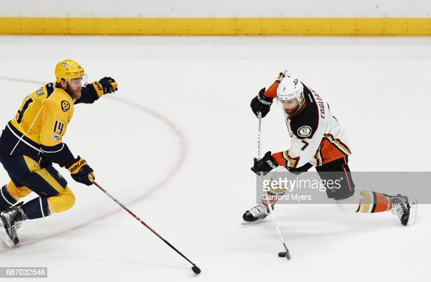 Andrew Cogliano of the Anaheim Ducks controls the puck against Mattias Ekholm of the Nashville Predators during the second period in Game Six of the...
