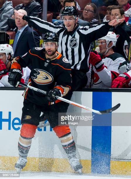 Andrew Cogliano of the Anaheim Ducks reacts as linesman Travis Gawryletz waves play on during the first period of the game against the New Jersey...
