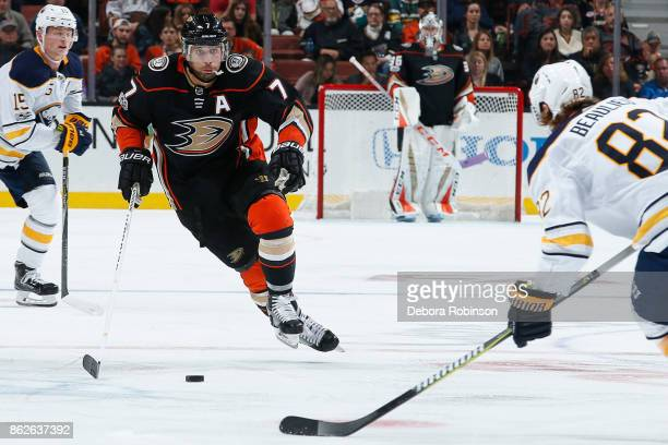 Andrew Cogliano of the Anaheim Ducks skates with the puck against Nathan Beaulieu of the Buffalo Sabres during the game on October 15 2017 at Honda...