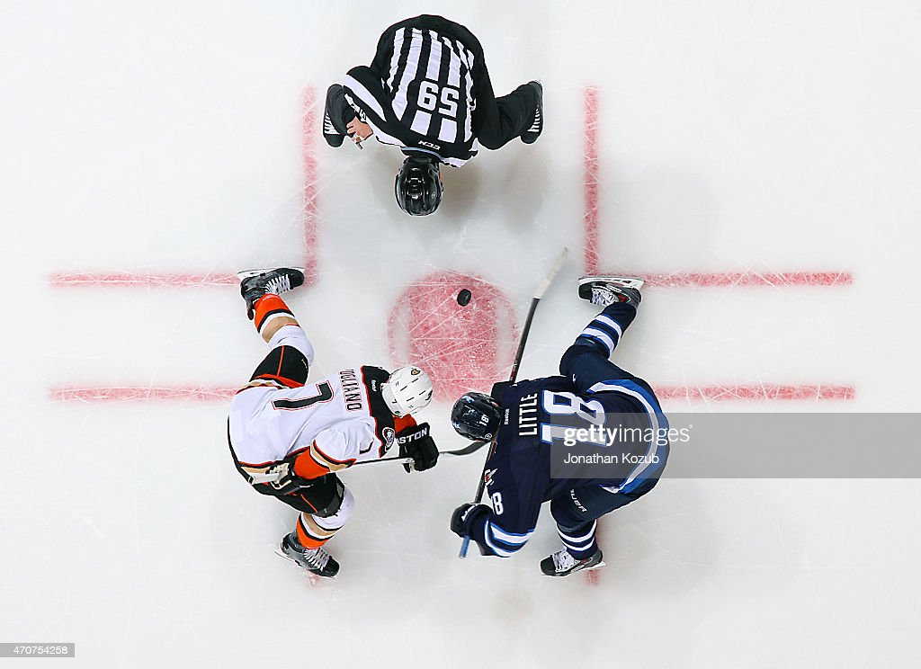 Andrew Cogliano #7 of the Anaheim Ducks takes a second period face-off against Bryan Little #18 of the Winnipeg Jets in Game Four of the Western Conference Quarterfinals during the 2015 NHL Stanley Cup Playoffs on April 22, 2015 at the MTS Centre in Winnipeg, Manitoba, Canada.