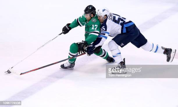 Andrew Cogliano of the Dallas Stars controls the puck against Mark Scheifele of the Winnipeg Jets in the third period at American Airlines Center on...