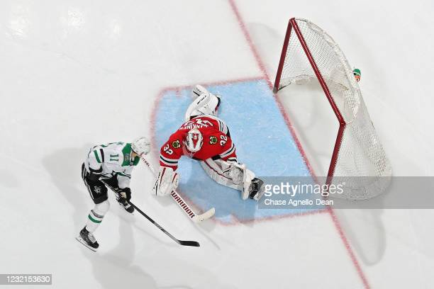 Andrew Cogliano of the Dallas Stars scores a goal past Kevin Lankinen of the Chicago Blackhawks in the third period at the United Center on April 06,...