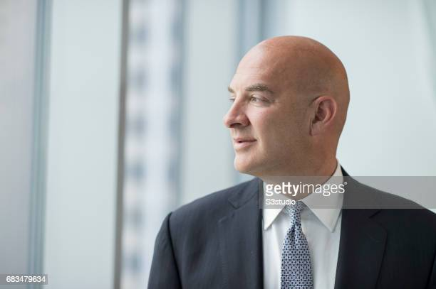 Andrew Cohen, Chief Executive Officer of J.P. Morgan Private Bank in Asia poses for a portrait at the company headquarters in Hong Kong on 14 August...