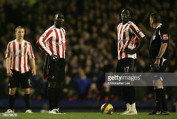 Andrew Cole and Kenwyne Jones of Sunderland dejectedly prepare to kick off after conceding a goal during the Barclays Premier League match between...