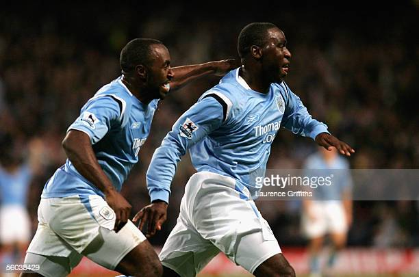Andrew Cole of Manchester City celebrates scoring his side's third goal with Darius Vassell during the Barclays Premiership match between Manchester...