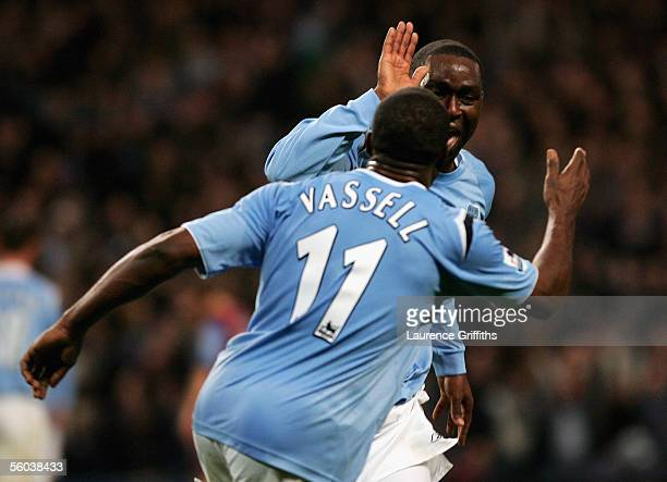 Andrew Cole of Manchester City celebrates scoring the third goal with Darius Vassell during the Barclays Premiership match between Manchester City...