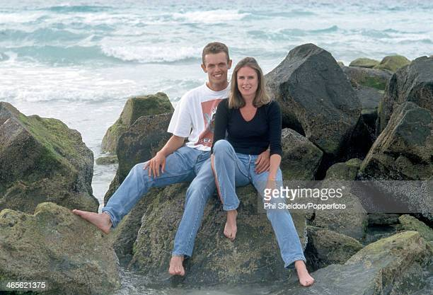 Andrew Coltart of Great Britain sitting on rocks beside the sea with his girlfriend Emma during the Dubai Desert Classic Golf Tournament held at the...