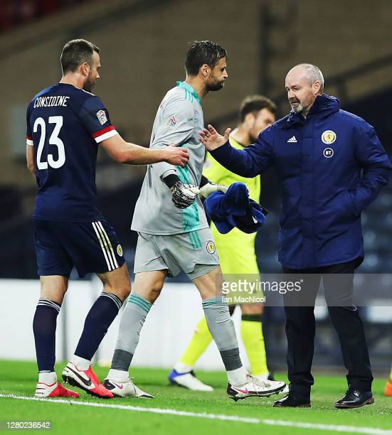 Andrew Considine is seen with Steve Clarke at full time during the UEFA Nations League group stage match between Scotland and Czech Republic at...