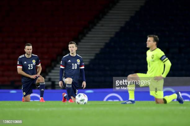 Andrew Considine of Scotland and Callum McGregor of Scotland takes a knee in support of the Black Lives Matter movement during the UEFA Nations...