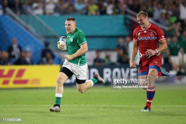 Andrew Conway of Ireland makes a break to score his sides fourth try during the Rugby World Cup 2019 Group A game between Ireland and Russia at Kobe...